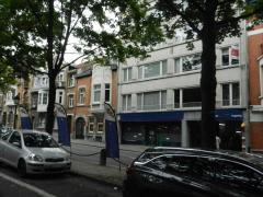 Voor 100 % van de aandelen over te nemen commerciële gebouwen en appartementen te Brussel Brussel Hoofdstad